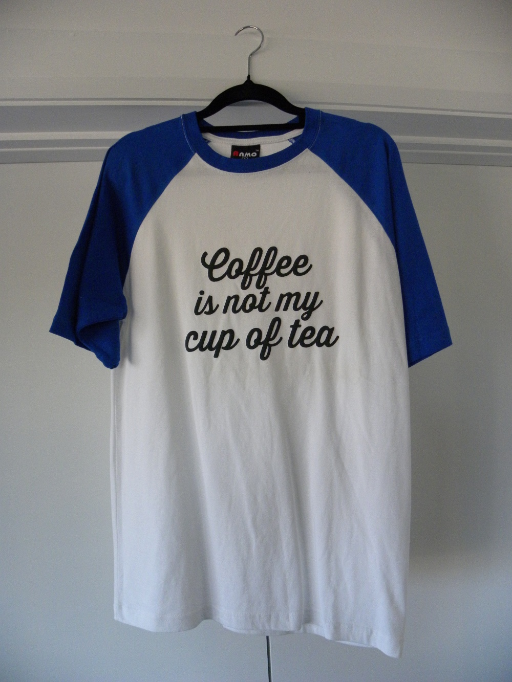 white with blue sleeves coffee is not my cup of tea